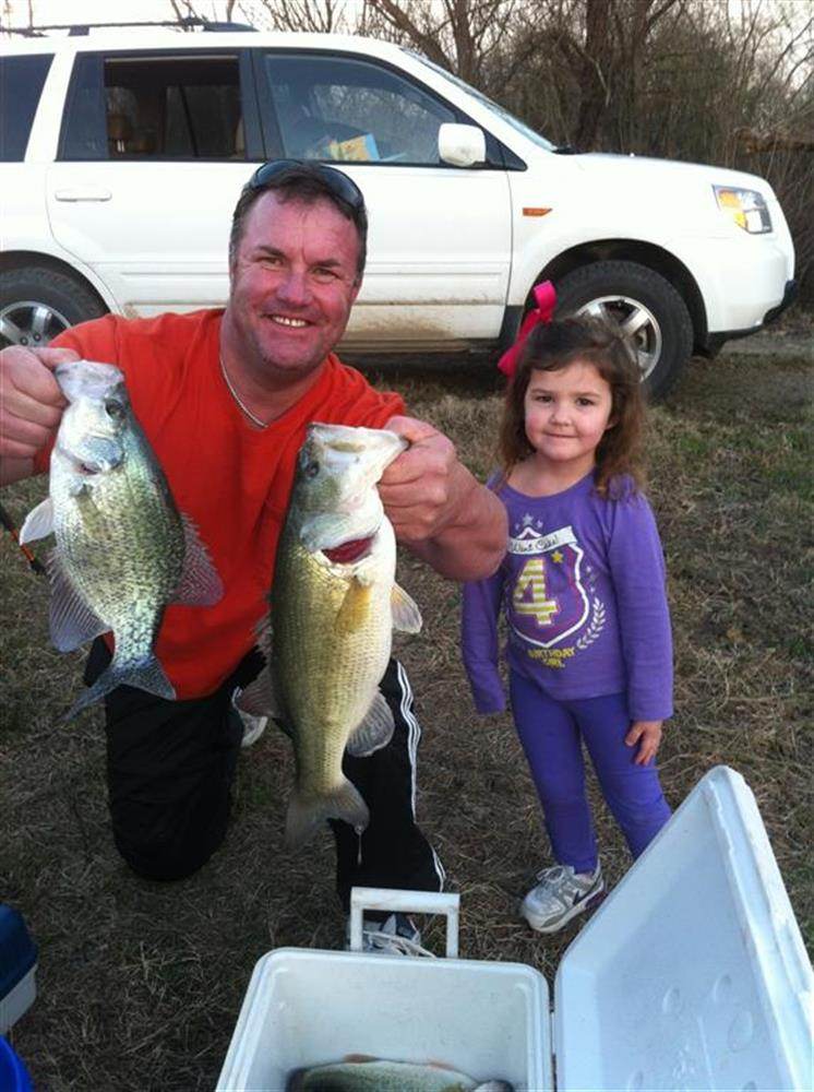 Catherine caught both fishes! Proud Daddy